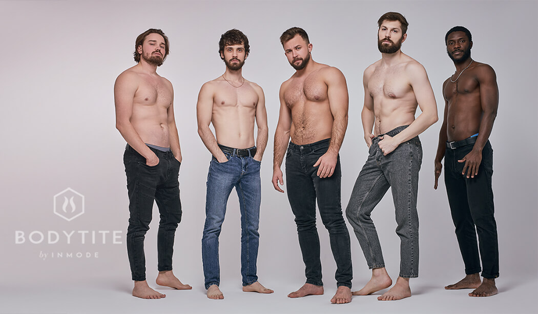 Confident fit guys with naked torso posing together, having serious look